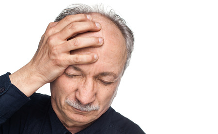 tired person: Elderly man suffering from a headache isolated on white background with copy-space