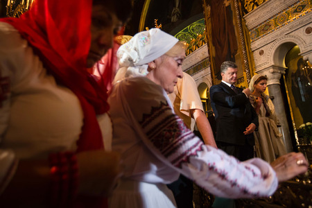 patriarchal: KIEV, UKRAINE - Jun 28, 2015: President of Ukraine Petro Poroshenko and his wife attended a festive liturgy at St. Vladimir Patriarchal cathedral in occasion of baptism of Kievan Rus-Ukraine