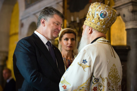 orison: KIEV, UKRAINE - Jun 28, 2015: President of Ukraine Petro Poroshenko and his wife and the Patriarch of Kyiv and All Rus-Ukraine, Primate of the Ukrainian Orthodox Church Kiev Patriarchate Filaret Editorial