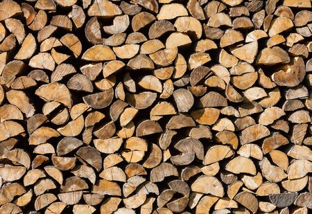 pile of logs: Pile of wood logs. Background of dry chopped firewood logs