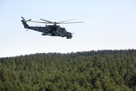 reg: DONETSK REG, UKRAINE - Aug 02, 2015: Ukrainian military helicopter Mi-24 (Hind) in flight on combat duty in the area of the antiterrorist operation