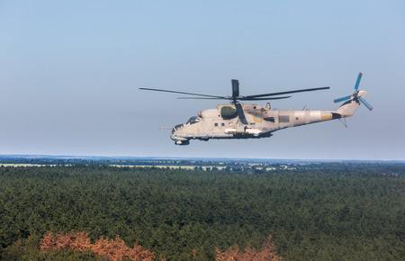 antiterrorist: DONETSK REG, UKRAINE - Aug 02, 2015: Ukrainian military helicopter Mi-24 (Hind) in flight on combat duty in the area of the antiterrorist operation