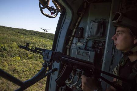 hitman: DONETSK REG, UKRAINE - Aug 02, 2015: Ukrainian army helicopter patrols the area of the antiterrorist operation in the Donetsk region Editorial