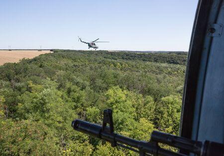 antiterrorist: DONETSK REG, UKRAINE - Aug 02, 2015: Ukrainian army helicopter patrols the area of the antiterrorist operation in the Donetsk region Editorial
