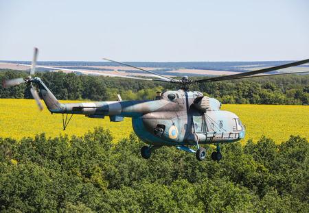 reg: DONETSK REG, UKRAINE - Aug 02, 2015: Ukrainian military helicopter Mi-8 (Hip) in flight on combat duty in the area of the antiterrorist operation Editorial