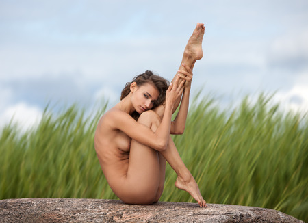 nude nature: Beautiful young nude woman on blurred nature background