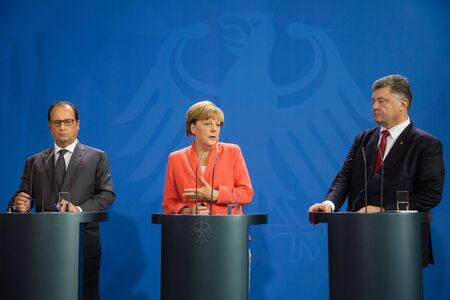 chancellor: BERLIN, GERMANY - Aug 24, 2015: French President Francois Hollande, Chancellor of Federal Republic of Germany Angela Merkel and President of Ukraine Petro Poroshenko during a joint briefing in Berlin Editorial