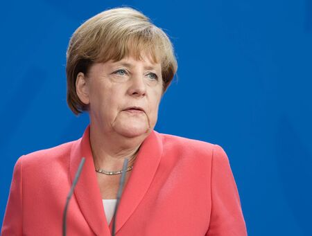 chancellor: BERLIN, GERMANY - Aug 24, 2015: Chancellor of the Federal Republic of Germany Angela Merkel during a joint briefing with President of Ukraine Petro Poroshenko and French President Francois Hollande Editorial