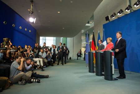 BERLIN, GERMANY - Aug 24, 2015: French President Francois Hollande, Chancellor of Federal Republic of Germany Angela Merkel and President of Ukraine Petro Poroshenko during a joint briefing in Berlin Editöryel