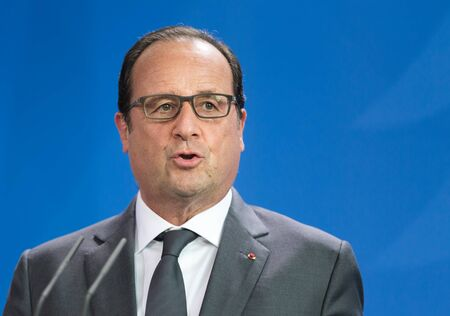 BERLIN, GERMANY - Aug 24, 2015: French President Francois Hollande during his meeting with German Chancellor Angela Merkel and the President of Ukraine Petro Poroshenko Editöryel