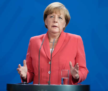 BERLIN, GERMANY - Aug 24, 2015: Chancellor of the Federal Republic of Germany Angela Merkel during a joint briefing with President of Ukraine Petro Poroshenko and French President Francois Hollande Editöryel