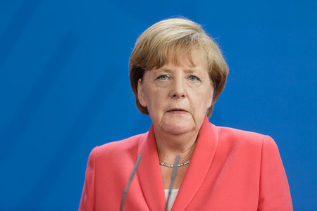 BERLIN, GERMANY - Aug 24, 2015: Chancellor of the Federal Republic of Germany Angela Merkel during a joint briefing with President of Ukraine Petro Poroshenko and French President Francois Hollande Éditoriale