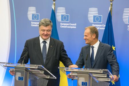 donald: BRUSSELS, BELGIUM - Aug 27, 2015: President of Ukraine Petro Poroshenko at a joint press conference with a President of the European Council Donald Tusk in Brussels