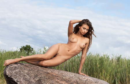 naked youth: Beautiful young nude woman on nature background Stock Photo