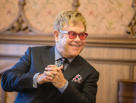 composer: KIEV, UKRAINE - Sep 12, 2015: World-famous musician, composer and singer Elton John well-known in world for his charitable activity in fight against AIDS against his meeting with President of Ukraine Petro Poroshenko Editorial
