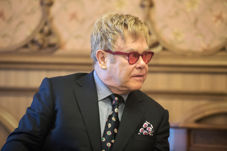 composers: KIEV, UKRAINE - Sep 12, 2015: World-famous musician, composer and singer Elton John well-known in world for his charitable activity in fight against AIDS against his meeting with President of Ukraine Petro Poroshenko Editorial