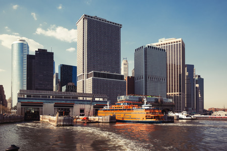 boroughs: NEW YORK, USA - May 04, 2015: Staten Island Ferry Whitehall Terminal in Lower Manhattan used by Staten Island Ferry, which connects two island boroughs of Manhattan and Staten Island in NYC