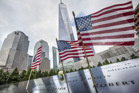NEW YORK, USA - Sep 27, 2015: Memorial to victims of Sept. 11, 2001. Memorial at World Trade Center Ground Zero. The memorial was dedicated on the 10th anniversary of the Sept. 11, 2001 attacks. Editoriali