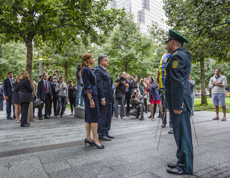 honored: NEW YORK, USA - Sep 27, 2015: President  of Ukraine Petro Poroshenko and his wife Maryna paid tribute to the victims of 11 September 2001 in New York (USA) Editorial