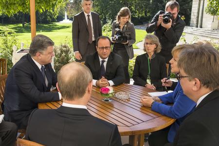 chancellor: PARIS, FRANCE - Oct 02, 2015: German Chancellor Merkel, Russian President Vladimir Putin, President Ukraine Petro Poroshenko and French President Francois Hollande on the meeting in Normandy format