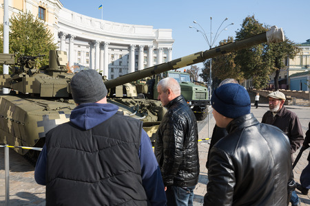 unbroken: KIEV, UKRAINE - Oct 16, 2015: Power of Unbroken. Exhibition of military equipment on the occasion of the Day of Defender of Ukraine. Visitors of the exhibition are considering military equipment
