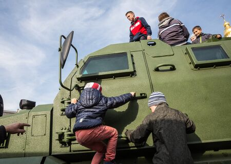 unbroken: KIEV, UKRAINE - Oct 17, 2015: Exhibition of military equipment Power of Unbroken on the occasion of the Day of Defender of Ukrain. Children are considering military equipment