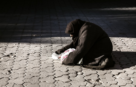 beggary: Poor woman on the street begging for money