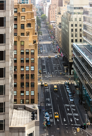 boroughs: NEW YORK, USA - Sep 27, 2015: Streets of Manhattan. Manhattan is the most densely populated of the five boroughs of New York City Editorial