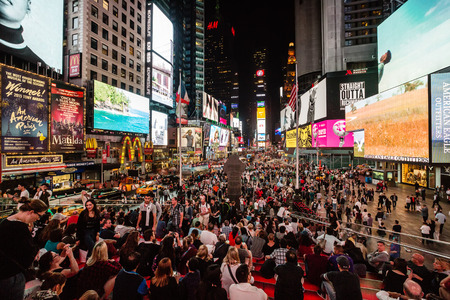 boroughs: NEW YORK, USA - Sep 27, 2015: Times Square at night. Streets of Manhattan. Manhattan is the most densely populated of the five boroughs of New York City Editorial
