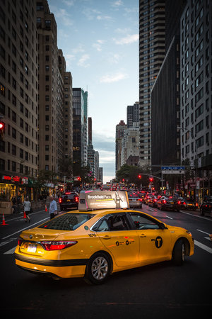 boroughs: NEW YORK, USA - Sep 29, 2015: Streets of Manhattan in the evening. Manhattan is the most densely populated of the five boroughs of New York City
