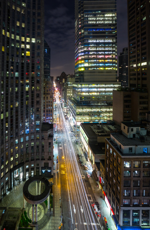 boroughs: NEW YORK, USA - Sep 29, 2015: Streets of Manhattan at night. Manhattan is the most densely populated of the five boroughs of New York City