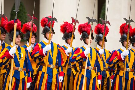 VATICAN CITY, VATICAN - Nov 20, 2015: Papal Swiss Guard in uniform. Currently, the name Swiss Guard generally refers to the Pontifical Swiss Guard of the Holy See stationed at the Vatican in Rome Redakční