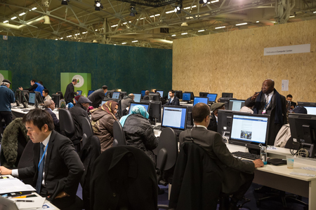 un: PARIS, FRANCE - Nov 30, 2015: Hard work in the press centre during the 21st session of the UN Conference on Climate Change