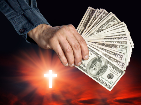 cupidity: Religion as a business. Religion, faith and money concept Stock Photo