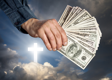penury: Religion as a business. Religion, faith and money concept Stock Photo