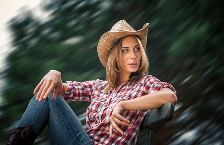 sexy cowgirl: Sexy cowgirl. Young woman portrait in a hat