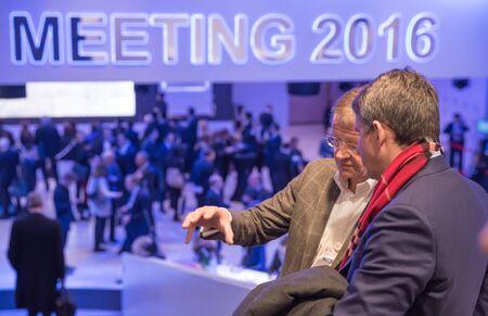 economics: DAVOS, SWITZERLAND - Jan 21, 2016: Working moments. Participants of the World Economic Forum in Davos (Switzerland)