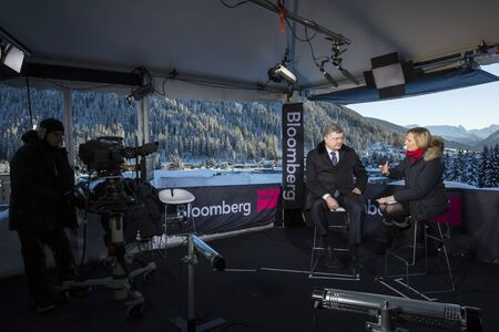 providers: DAVOS, SWITZERLAND - Jan 21, 2016: President of Ukraine Petro Poroshenko during an interview with one of the leading providers of financial information Bloomberg in Davos (Switzerland) Editorial