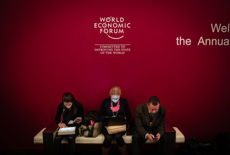 swiss insignia: DAVOS, SWITZERLAND - Jan 22, 2016: Working moments during World Economic Forum Annual Meeting 2016 in Davos, Switzerland