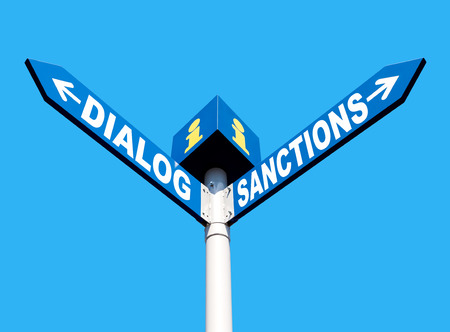 sanctioned: Political metaphor concept. Waymark with the words DIALOG and SANCTIONS isolated on blue background