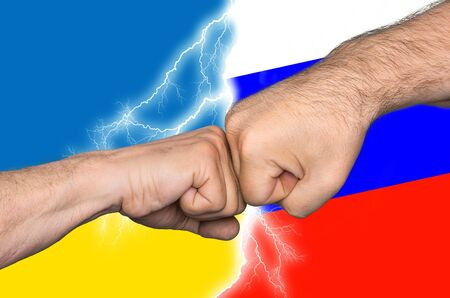 imperialism: Fight. Political metaphor. Russian Ukrainian conflict. Two men bumping fists against Ukrainian and Russian flags Stock Photo