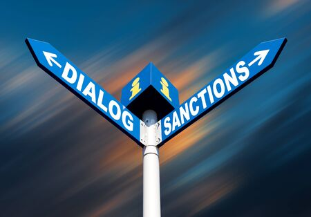 deterrent: Political metaphor concept. Waymark with the words DIALOG and SANCTIONS against abstract blurred background