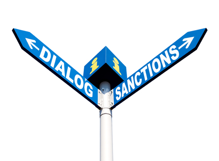 Political metaphor concept. Waymark with the words DIALOG and SANCTIONS isolated on white background