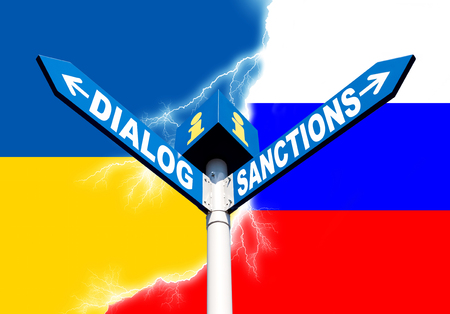 Political metaphor concept. Waymark with the words DIALOG and SANCTIONS against of the Ukrainian and Russian flags symbolizing the the conflict of civilizations Stock Photo