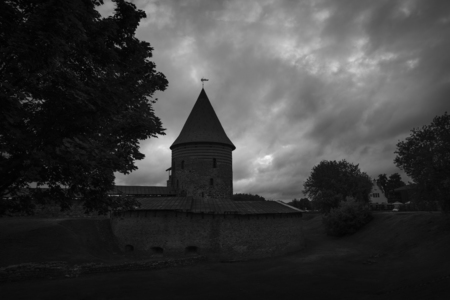 kaunas: Silhouette of historical gothic Kaunas Castle from medieval times in Kaunas, Lithuania. Black and white image in low key