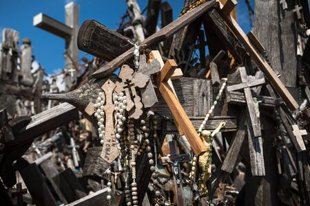 christian crosses: SIAULIAI, LITHUANIA - JUL 12, 2015: Hill of Crosses is a unique monument of history and religious folk art and the most important Lithuanian Catholic pilgrimage site