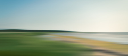 sea grass: Abstract blurred sea landscape with grass on the beach and blue sky