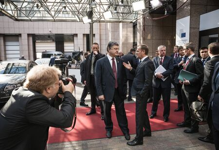 donald: BRUSSELS, BELGIUM - Mar 17, 2016: President of Ukraine Petro Poroshenko and President of the European Council Donald Tusk during a meeting in Brussels