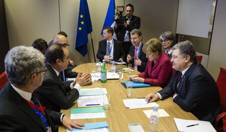 chancellor: BRUSSELS, BELGIUM - Mar 17, 2016: French President Francois Hollande, German Chancellor Angela Merkel and the President of Ukraine Petro Poroshenko during a meeting in Brussels
