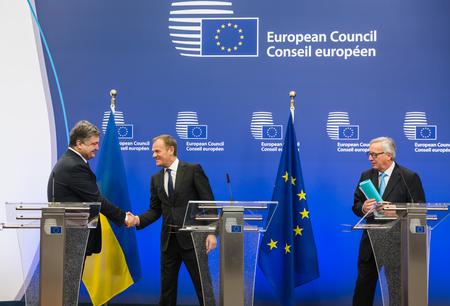 tusk: BRUSSELS, BELGIUM - Mar 17, 2016: President of Ukraine Petro Poroshenko, President of European Council Donald Tusk and European Commission President Jean-Claude Juncker during a meeting in Brussels Editorial